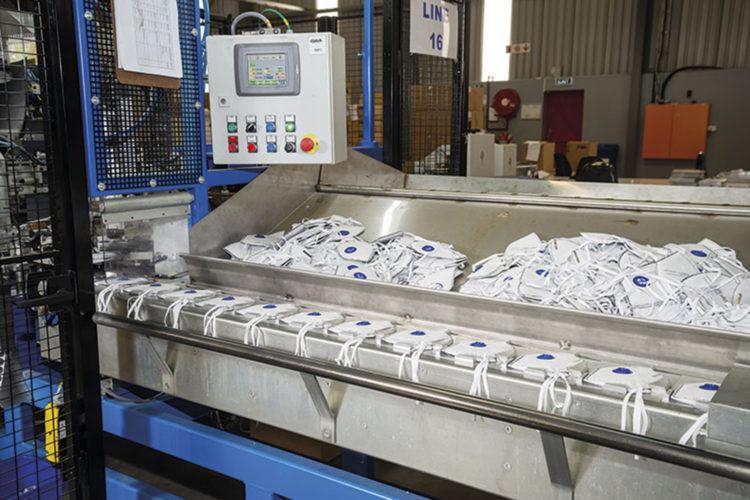 Producción de mascarillas FFP.